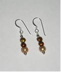 Golden freshwater pearl sterling earrings. Matching necklace with same number E1013 $26.00