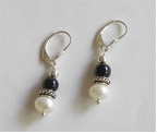 Onyx and pearl sterling earrings.$28.00