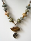 "Close up of tiger's eye and smokey quartz pendant necklace.  19.75"" long 