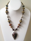 "Reddish brown jasper and sterling pendant on jasper necklace.  Great shapes for a distinct look. SG2054  19.75-20.75"" long"