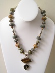 "Tiger's eye and smokey quartz sterling pendant on ocean jasper necklace. TR2055  $155.00  19-20"" long on expandable sterlin"