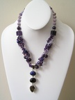 Triple sterling pendant of smokey quartz, amethyst and lapis on triple strand of pearls and amethyst necklace.